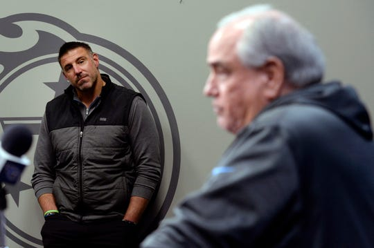 Titans coach Mike Vrabel listens as defensive coordinator Dean Pees announces his retirement from football and the team at Saint Thomas Sports Park on Jan. 20.