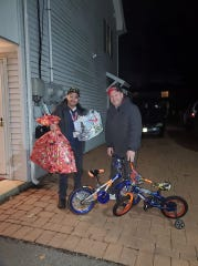 MikeMattessich, right, the founder of Bikes 4 Veterans and Others in Need, is with AJ Luna, left, director of the Bergen County Veterans Services on Dec. 23 when donating bikes to a family in Fort Lee.