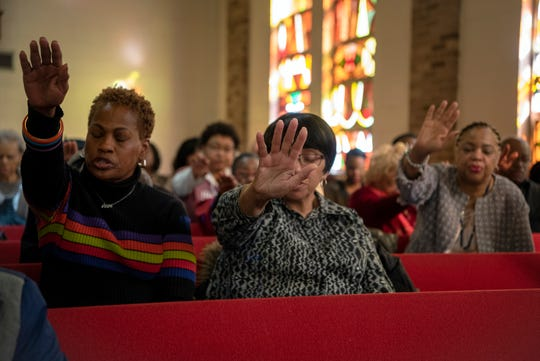 Ebenezer Baptist Church in Englewood commemorated MLK Day 2020 with a worship service on January 20, 2020. Attendees pray for Bishop Dwayne D. Royster, a guest from Washington D.C., delivering the message during the service.