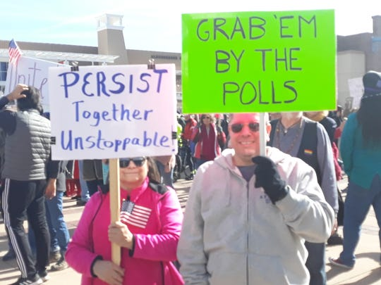 """Attendees at the 2020 New Mexico Women's March in Albuquerque's Civic Plaza display signs on Sunday, Jan. 19, 2020. The theme of the event was """"Women Rising."""""""