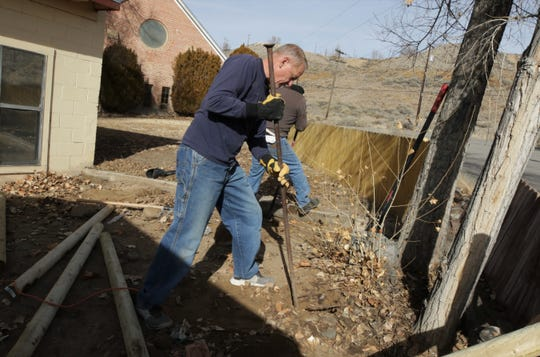 Eddie Felder, the pastor of Summit Church, works to put fence posts in the ground while volunteering during the Four Corners Annual Martin Luther King Jr. Day of Service at New Beginnings in Farmington.
