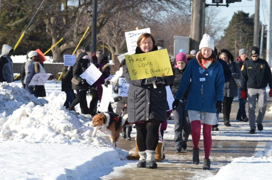 The Peace Walkers marched along 12 Mile Road, from the library to just west of Hamilton Court and back.