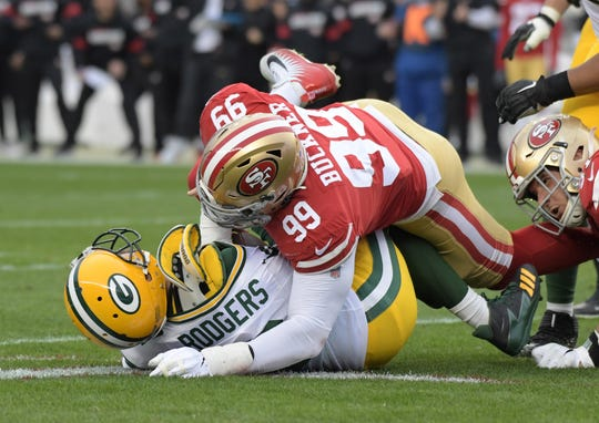 Jan 19, 2020; Santa Clara, California, USA; Green Bay Packers quarterback Aaron Rodgers (12) is sacked by San Francisco 49ers defensive end Nick Bosa (97) and defensive tackle DeForest Buckner (99) in the first half of the NFC Championship Game at Levi's Stadium. Mandatory Credit: Kirby Lee-USA TODAY Sports