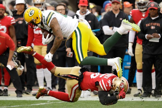 Green Bay Packers tight end Marcedes Lewis, top, is tackled by San Francisco 49ers middle linebacker Kwon Alexander during the first half of the NFL NFC Championship football game Sunday, Jan. 19, 2020, in Santa Clara, Calif. (AP Photo/Ben Margot)