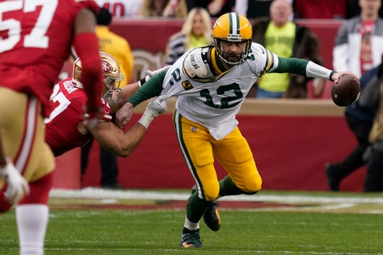 Green Bay Packers quarterback Aaron Rodgers (12) is sacked by San Francisco 49ers defensive end Nick Bosa during the first half of the NFL NFC Championship football game Sunday, Jan. 19, 2020, in Santa Clara, Calif. (AP Photo/Tony Avelar)