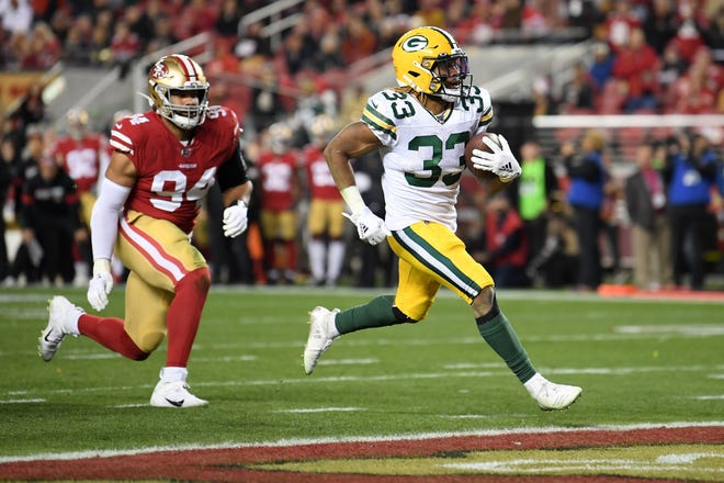 SANTA CLARA, CALIFORNIA - JANUARY 19: Aaron Jones #33 of the Green Bay Packers runs for a touchdown against the San Francisco 49ers during the second half of the NFC Championship game at Levi's Stadium on January 19, 2020 in Santa Clara, California. (Photo by Harry How/Getty Images)