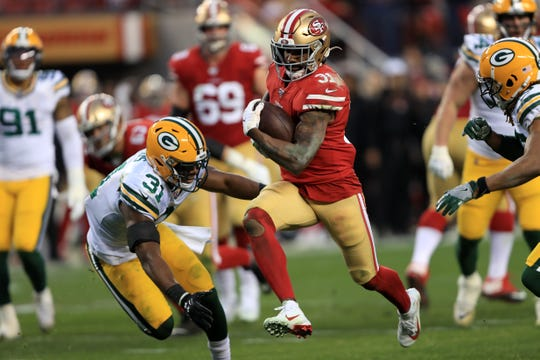 SANTA CLARA, CALIFORNIA - JANUARY 19: Raheem Mostert #31 of the San Francisco 49ers runs for a touchdown in the second quarter against the Green Bay Packers during the NFC Championship game at Levi's Stadium on January 19, 2020 in Santa Clara, California. (Photo by Sean M. Haffey/Getty Images)