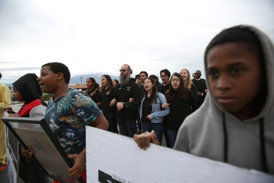 """Desert Hot Springs High School choir members sing """"We Shall Overcome"""" during the Martin Luther King Jr. Unity Walk organized by the Desert Hot Springs Christian Ministerial Fellowship on Jan. 20, 2020."""