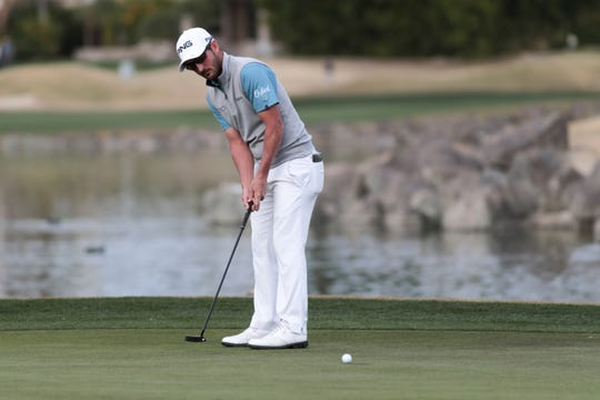 Andrew Landry rolls in a 6-foot birdie putt on the 18th hole Sunday to cap his two-shot victory in the American Express PGA West.