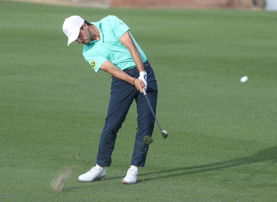 Abraham Ancer hits an approach shot on the 18th hole of the American Express Golf Tournament at the Stadium Course of PGA West in La Quinta, January 19, 2020.