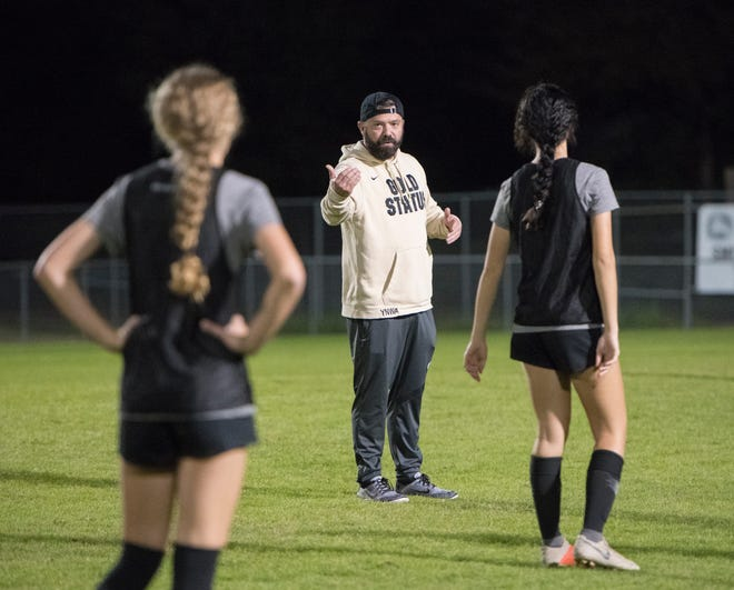 Jeff Klug coaches his players at Milton last season. He was named Gulf Breeze girls soccer head coach on Thursday.