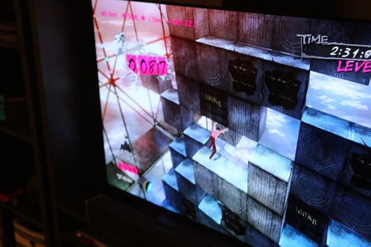 """A screen grab of the video game """"Catherine,"""" in which the object is for the players to solve puzzles and move blocks to create a path for their character to advance through an obstacle course."""