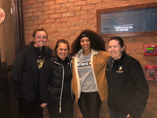 Northeastern junior Jiselle Castano, center right, poses with the Army West Point softball coaching staff during her official visit. Castano committed to play softball for Army.