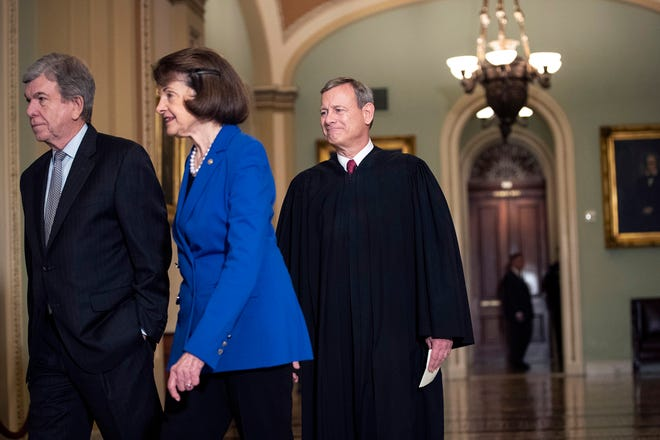 From left, Sen. Roy Blunt (R-Mo.), Sen. Dianne Feinstein (D-Calif.) and Supreme Court Chief Justice John Roberts arrive to the Senate chamber for impeachment proceedings at the U.S. Capitol in Washington, D.C., on Thursday, Jan. 16, 2020. (Drew Angerer/Getty Images/TNS)