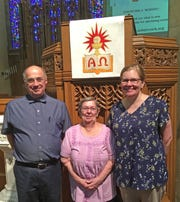 Inside the sanctuary of Asbury United Methodist Church are (from left): Rev. Chuck Sprenkle, Shirley Baker and Rachel Stambach.