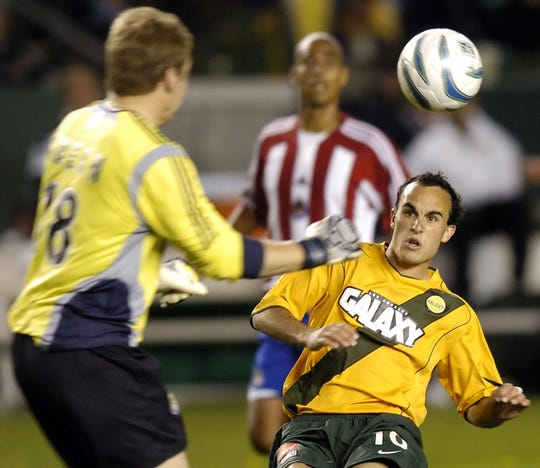 Chivas USA goalie Brad Guzan, left, moves to intercept a shot by Los Angeles Galaxy's Landon Donovan, right, in Carson, Calif., on  April 23, 2005. The Galaxy won 3-1.