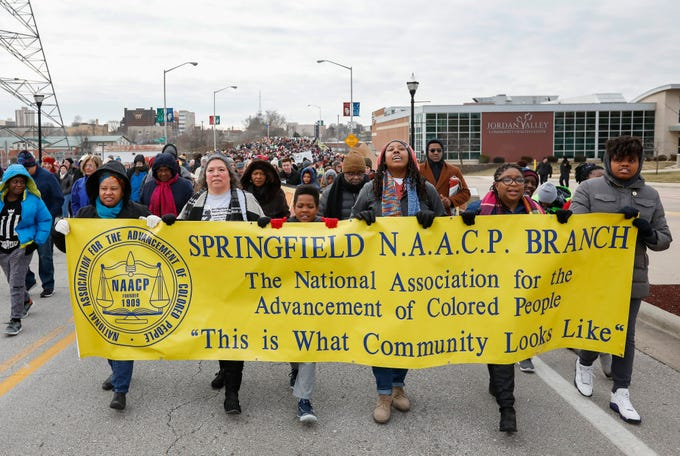 Hundreds of people march across the Martin Luther King Jr. Bridge in Springfield on Monday, Jan. 20, 2020.