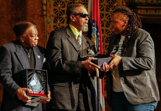 Toni Robinson, president of the Springfield branch of the NAACP, right, presents a plaque to Denny Whayne, center, and Calvin Allen, left, during the program for Martin Luther King Jr. Day at the Gillioz Theatre on Monday, Jan. 20, 2020.