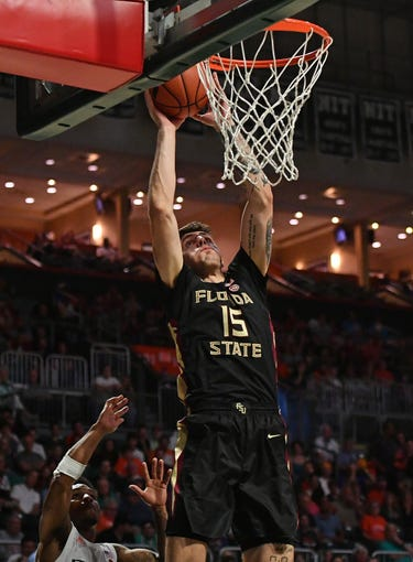 Jan 18, 2020; Coral Gables, Florida, USA; Florida State Seminoles center Dominik Olejniczak (15) shoots the ball against the Miami Hurricanes during the first half at Watsco Center. Mandatory Credit: Jasen Vinlove-USA TODAY Sports