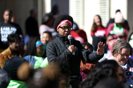 "Kai Williams, 11, a sixth grader at Cobb Middle School, addresses her concerns over the microphone during the ""Silence is Not an Option"" program held after the Martin Luther King Jr. commemorative rally in the Capitol Courtyard Monday, Jan. 20, 2020."
