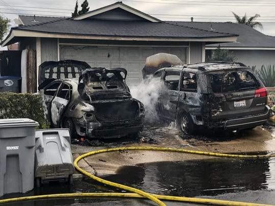 Oxnard firefighters and police responded to a vehicle fire outside a home that injured a woman Monday afternoon.