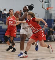 Chelsea Ogyiri of Saunders drives while being defended by Lina Dimarsico of North Rockland during a varsity basketball game at Saunders High School in Yonkers Jan. 20, 2020. North Rockland defeated Saunders 66-51.