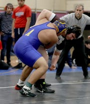 George Lebberes of Ardsley defeated Joe Nolan of Ossining 3-2 to win the 285 pounds championship at the Westchester County Wrestling Championships at Lincoln High School in Yonkers Jan. 19, 2020.