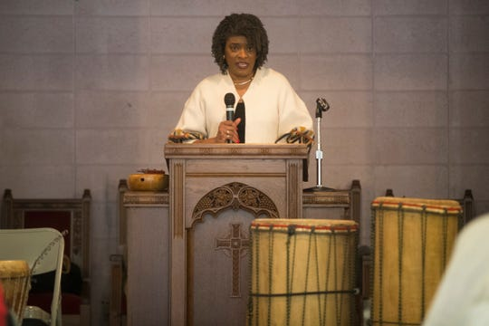Velda Jones-Potter speaks during the 31st annual Children's Birthday Party in honor of Dr. Martin Luther King Jr. Monday at Ezion-Mount Carmel United Methodist Church in Wilmington.