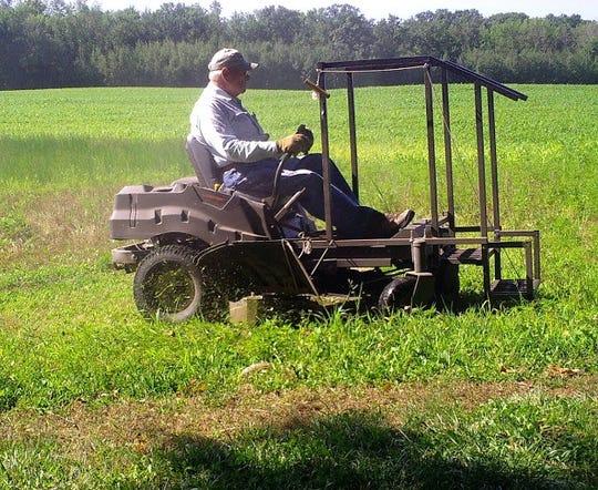 Bob having fun on his mower.