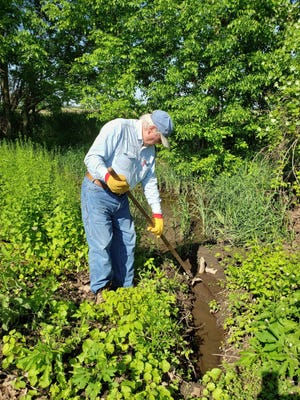 Bob cleaning out field culvert after a June 6, 2019 oncologist doctor appointment. You couldn't keep him down.