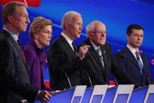 From left, Tom Steyer, Sen. Elizabeth Warren of Massachusetts, former Vice President Joe Biden, Sen. Bernie Sanders of Vermont and Mayor Pete Buttigieg of South Bend, Indiana, at the Democratic presidential primary debate on Jan. 14, 2020, in Des Moines, Iowa.