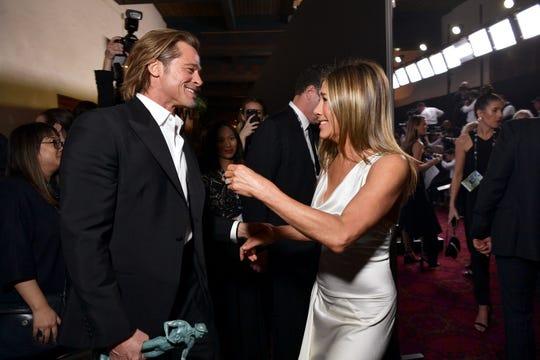 Brad Pitt and Jennifer Aniston greet each other backstage.