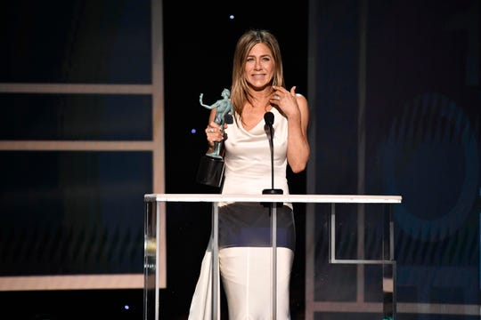 "Jennifer Aniston accepts the award for outstanding performance by a female actor in a drama series for her role as Alex Levy in ""The Morning Show"" during the 26th Annual Screen Actors Guild Awards."
