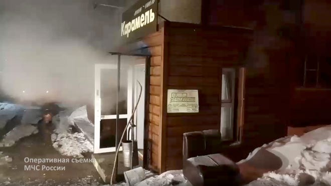 In this image made from video provided by Russian Emergency Situations Ministry press service, shows a view of a damaged hotel of nine rooms located in the basement of a residential building which was flooded with boiling water after a pipe ruptured in Perm, Russia, Monday, Jan. 20, 2020. Russian emergency services say heating pipe damage caused deaths and injuries. (Ministry of Emergency Situations press service via AP) ORG XMIT: XAZ101
