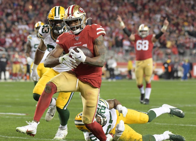 San Francisco 49ers running back Raheem Mostert (31) scores a touchdown against the Green Bay Packers in the third quarter of the NFC Championship Game at Levi's Stadium.