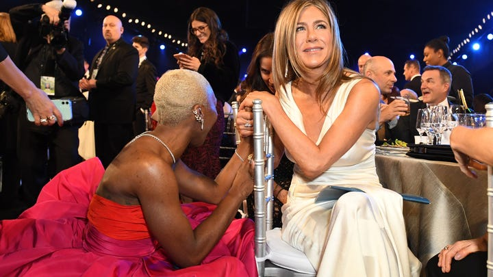 Cynthia Erivo and Jennifer Aniston get together during a SAG Awards commercial break.