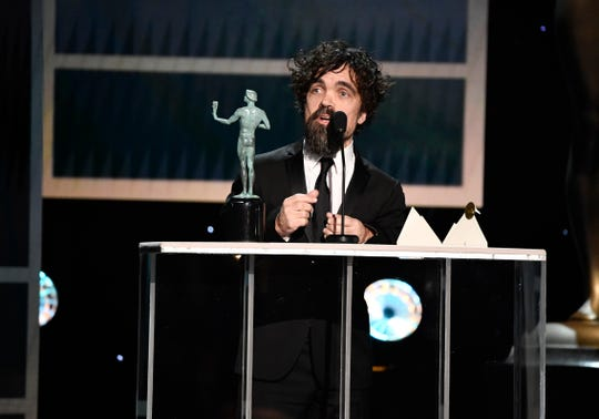 "Peter Dinklage accepts the award for outstanding performance by a male actor in a drama series for his role as Tyrion Lannister in ""Game of Thrones"" during the 26th Annual Screen Actors Guild Awards."