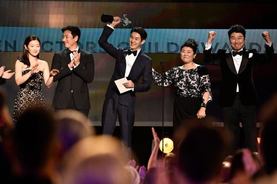 """Parasite"" stars Park So-dam (far left), Lee Sun-kyun, Choi Woo-shik, Lee Jeong-eun and Song Kang-ho celebrate their best-ensemble win at the 2020 Screen Actors Guild Awards."