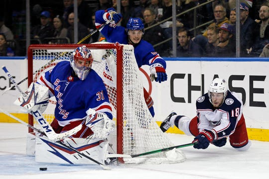 Columbus Blue Jackets center Pierre-Luc Dubois attempts a wrap around shot against New York Rangers goaltender Igor Shesterkin during the third period at Madison Square Garden.