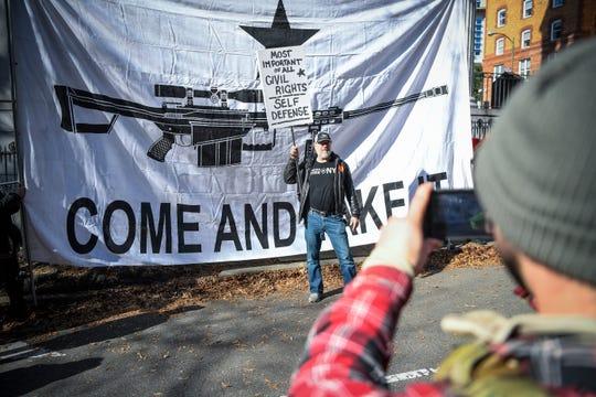 Gun rights advocates and militia members gather in Virginia's capitol to protest potential gun control bills.