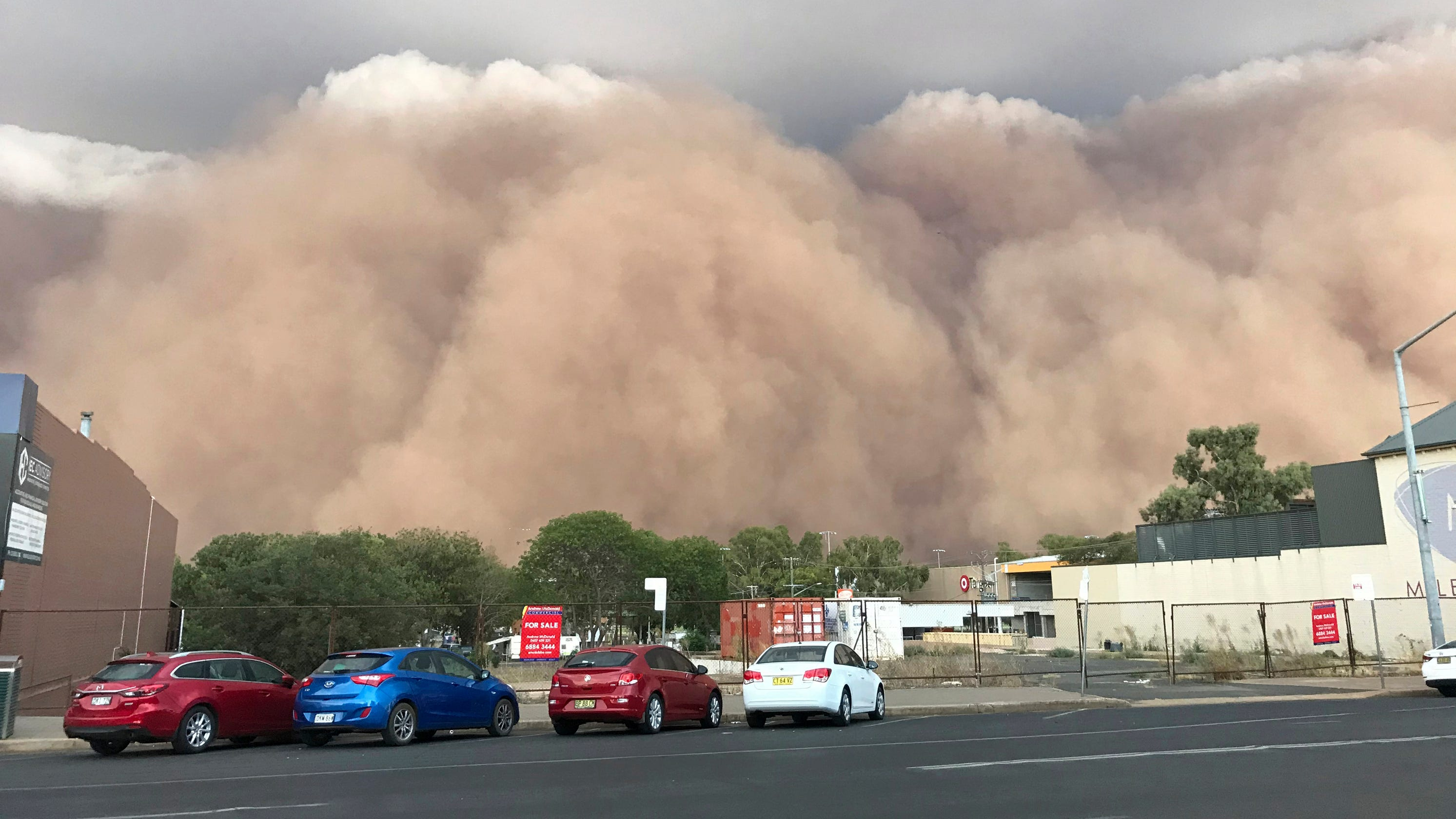 Australia wildfires: Floods, hail hit Canberra, dust storm ...