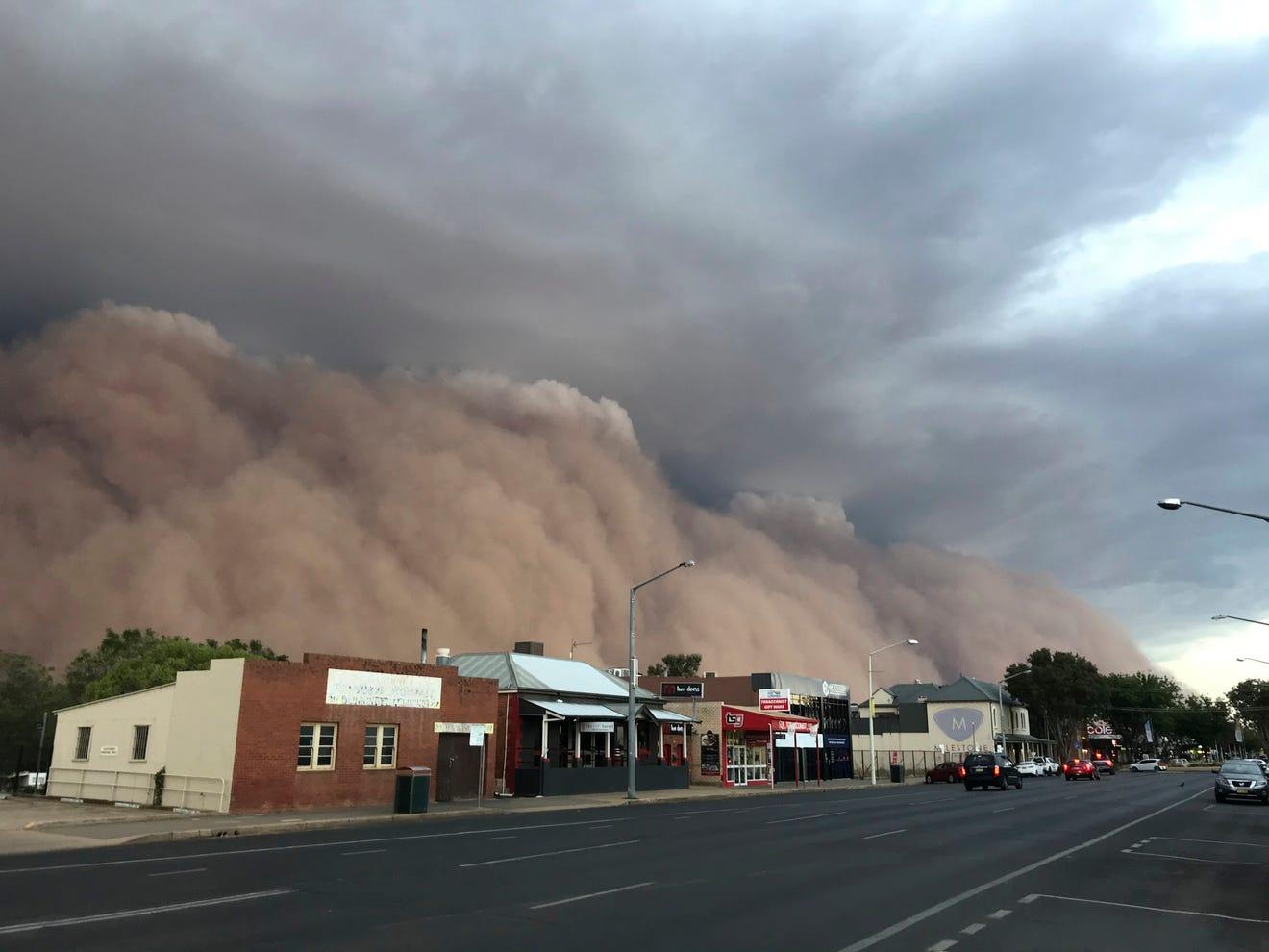 Australia wildfires, floods, hail, hit Canberra