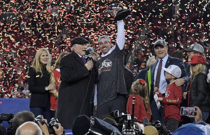 49ers head coach Kyle Shanahan hoists the George Halas Trophy after defeating the Packers the NFC championship game at Levi's Stadium.