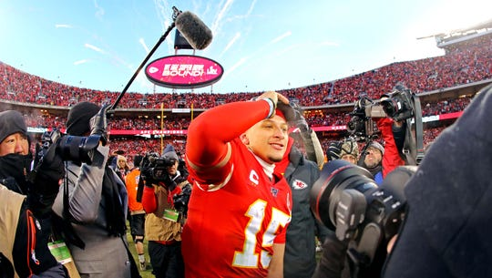 Chiefs QB Patrick Mahomes celebrates after winning the AFC championship game.