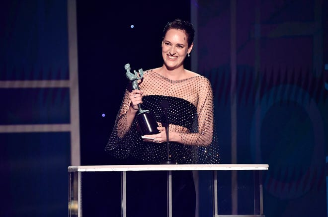 """Phoebe Waller-Bridge, seen accepting a Screen Actors Guild award for """"Fleabag,"""" will produce and star with Donald Glover in a TV series version of """"Mr. and Mrs. Smith,"""" the 2005 film famed for pairing Brad Pitt and Angelina Jolie."""
