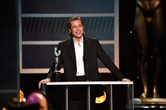 "Brad Pitt accepts the award for outstanding performance by a male actor in a supporting role for his role as Cliff Booth in ""Once Upon a Time in Hollywood"" during the 26th Annual Screen Actors Guild Awards."