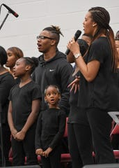 """Shernessa Guyton sings a solo with the MLK Youth Community Choir singing """"Mention"""" during the Martin Luther King Jr. celebration service, held by the Anderson County Ministers Organization at the Civic Center of Anderson Monday."""