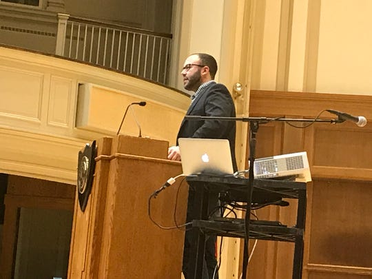 Simon Balto, a professor of African American history at the University of Iowa, speaks atf the annual Martin Luther King Jr. Day celebration at Lawrence Memorial Chapel in Appleton.