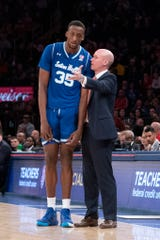 Seton Hall Pirates Head Coach Kevin Willard speaks with Romaro Gill (35) against St. John's