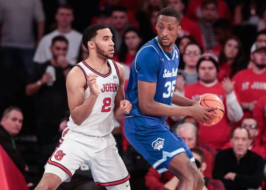 Seton Hall Pirates center Romaro Gill (35) protects the ball from St. John's Red Storm guard Julian Champagnie